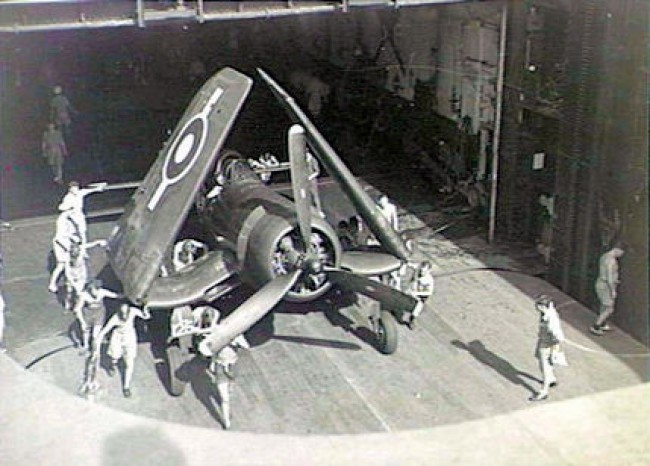data/extra_images/2016/Corsair_being_pushed_on_elevator_HMS_Glory_(R62)_1945.jpg